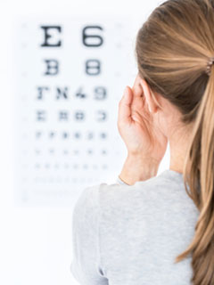image of woman doing an eye test.